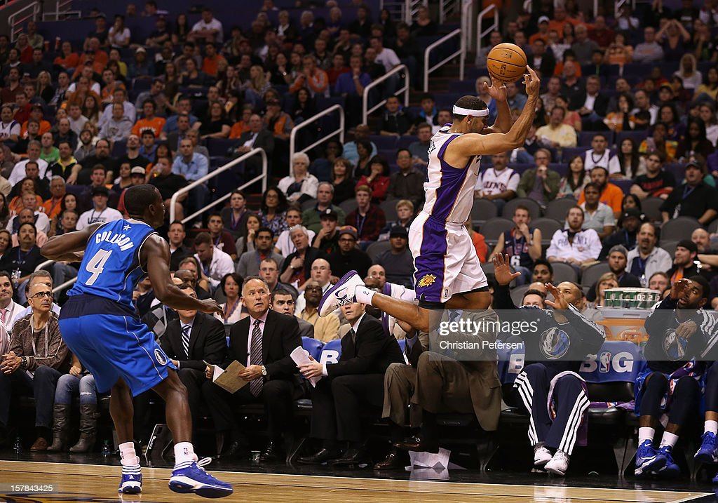 <a gi-track='captionPersonalityLinkClicked' href=/galleries/search?phrase=Jared+Dudley&family=editorial&specificpeople=224071 ng-click='$event.stopPropagation()'>Jared Dudley</a> #3 of the Phoenix Suns attempts to save an out of bounds ball while falling onto <a gi-track='captionPersonalityLinkClicked' href=/galleries/search?phrase=Derek+Fisher&family=editorial&specificpeople=201724 ng-click='$event.stopPropagation()'>Derek Fisher</a> #6 of the Dallas Mavericks during the NBA game at US Airways Center on December 6, 2012 in Phoenix, Arizona. The Mavericks defeated the Suns 97-94.