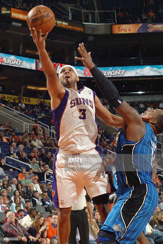 <a gi-track='captionPersonalityLinkClicked' href=/galleries/search?phrase=Jared+Dudley&family=editorial&specificpeople=224071 ng-click='$event.stopPropagation()'>Jared Dudley</a> #3 of the Phoenix Suns drives for a shot against <a gi-track='captionPersonalityLinkClicked' href=/galleries/search?phrase=Glen+Davis+-+Basketball+Player&family=editorial&specificpeople=709385 ng-click='$event.stopPropagation()'>Glen Davis</a> #11 of the Orlando Magic on December 9, 2012 at U.S. Airways Center in Phoenix, Arizona.