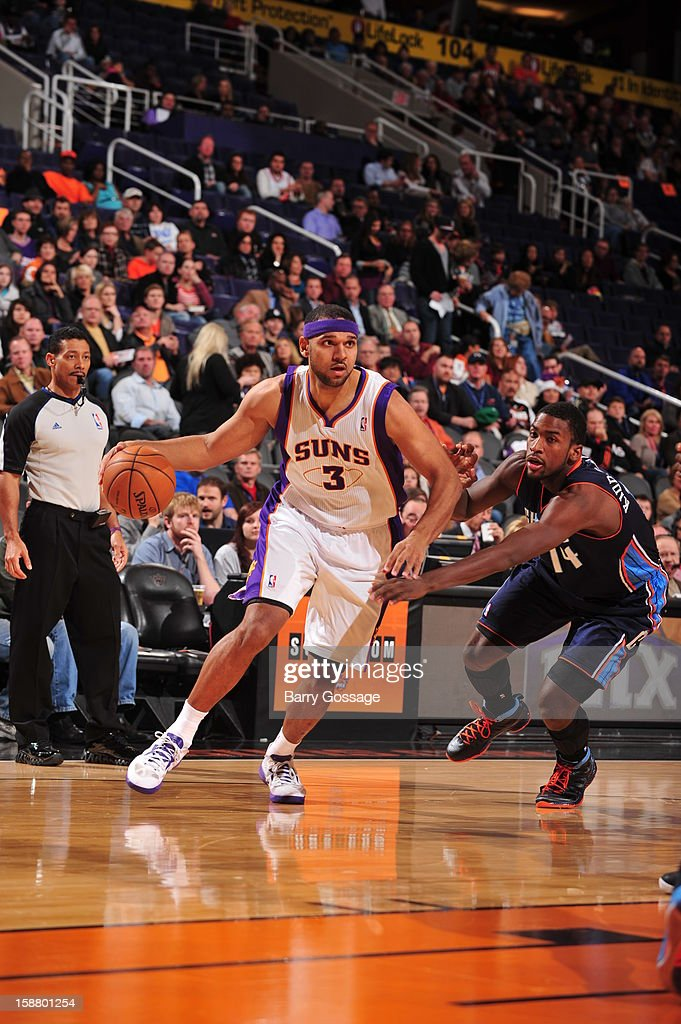 <a gi-track='captionPersonalityLinkClicked' href=/galleries/search?phrase=Jared+Dudley&family=editorial&specificpeople=224071 ng-click='$event.stopPropagation()'>Jared Dudley</a> #3 of the Phoenix Suns drives to the basket against <a gi-track='captionPersonalityLinkClicked' href=/galleries/search?phrase=Michael+Kidd-Gilchrist&family=editorial&specificpeople=8526214 ng-click='$event.stopPropagation()'>Michael Kidd-Gilchrist</a> #14 of the Charlotte Bobcats on December 19, 2012 at U.S. Airways Center in Phoenix, Arizona.
