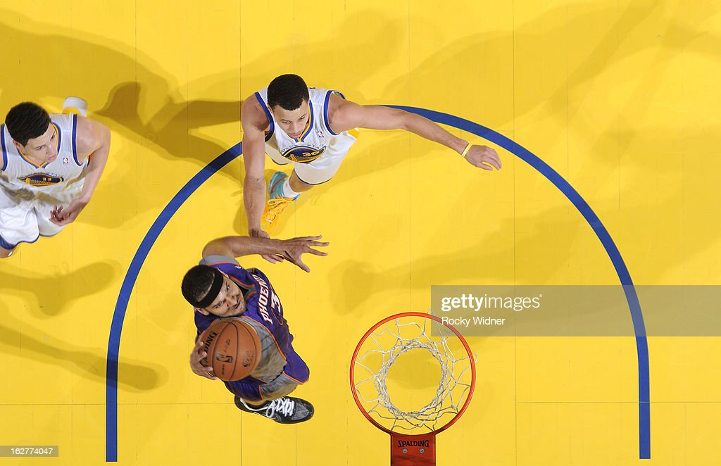 <a gi-track='captionPersonalityLinkClicked' href=/galleries/search?phrase=Jared+Dudley&family=editorial&specificpeople=224071 ng-click='$event.stopPropagation()'>Jared Dudley</a> #3 of the Phoenix Suns dunks against Stephen Curry #30 of the Golden State Warriors on February 20, 2013 at Oracle Arena in Oakland, California.
