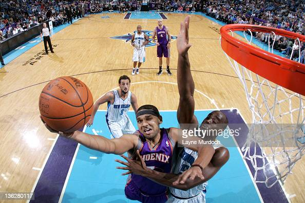 Jared Dudley of the Phoenix Suns goes up for a layup while being guarded by Emeka Okafor of the New Orleans Hornets during an NBA game on December 30...