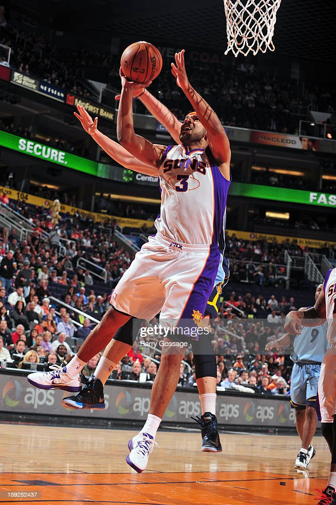 <a gi-track='captionPersonalityLinkClicked' href=/galleries/search?phrase=Jared+Dudley&family=editorial&specificpeople=224071 ng-click='$event.stopPropagation()'>Jared Dudley</a> #3 of the Phoenix Suns grabs a rebound against the Denver Nuggets on January 6, 2013 at U.S. Airways Center in Phoenix, Arizona.