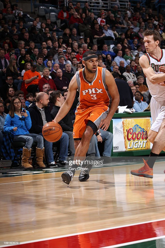 Jared Dudley #3 of the Phoenix Suns handles the ball against Mike Dunleavy #17 of the Milwaukee Bucks on January 8, 2013 at the BMO Harris Bradley Center in Milwaukee, Wisconsin.