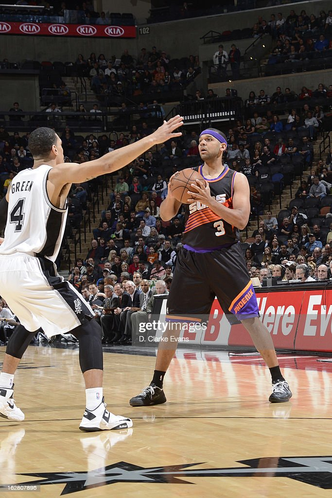 Jared Dudley #3 of the Phoenix Suns looks to pass the ball against Danny Green #4 of the San Antonio Spurs on February 27, 2013 at the AT&T Center in San Antonio, Texas.