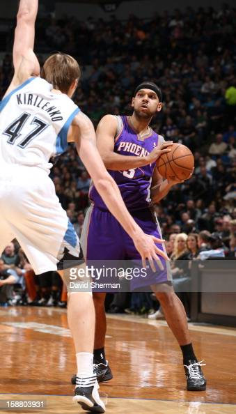 Jared Dudley of the Phoenix Suns plans his next move against Andrei Kirilenko of the Minnesota Timberwolves during the game between the Minnesota...