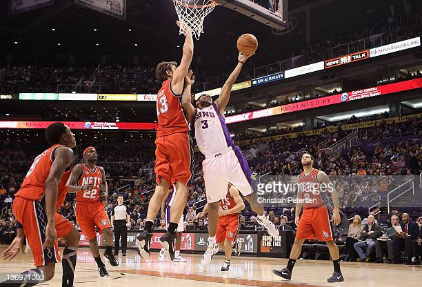 Jared Dudley of the Phoenix Suns puts up a shot against Mehmet Okur of the New Jersey Nets during the NBA game at US Airways Center on January 13...