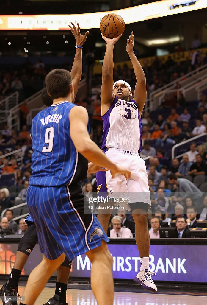 Jared Dudley #3 of the Phoenix Suns puts up a shot over Nikola Vucevic #9 of the Orlando Magic during the NBA game at US Airways Center on December 9, 2012 in Phoenix, Arizona. The Magic defeated the Suns 98-90.