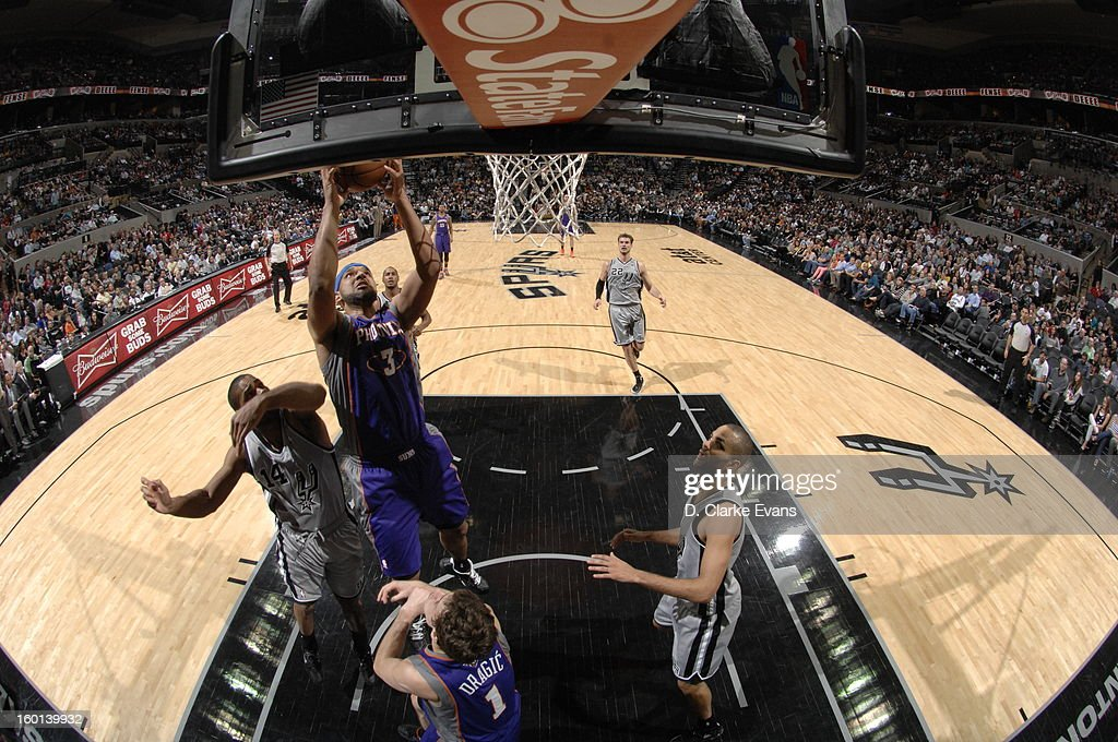Jared Dudley #3 of the Phoenix Suns rebounds against the San Antonio Spurs on January 26, 2013 at the AT&T Center in San Antonio, Texas.