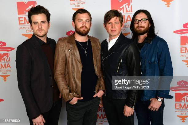 Jared Followill Caleb Followill Matthew Followill and Nathan Followill of Kings of Leon pose in the Exclusive Arrivals Studio during MTV EMA's 2013...