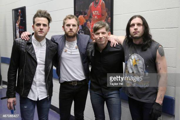 Jared Followill Caleb Followill Matthew Followill and Nathan Followill of Kings of Leon pose prior to the opening of the 'Mechanical Bull' tour at...