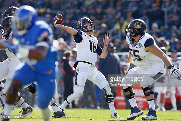 Jared Goff of the California Golden Bears looks for an open receiver against the Air Force Falcons in the first quarter at Amon G Carter Stadium on...