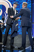 Jared Goff of the California Golden Bears shakes hands with NFL Commissioner Roger Goodell after being picked overall by the Los Angeles Rams during...