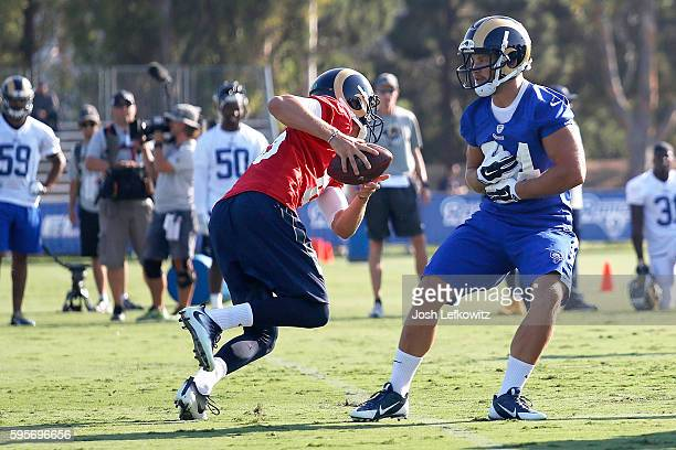 Jared Goff of the Los Angeles Rams fakes the handoff to Chase Reynolds during practice at Crawford Field on August 25 2016 in Irvine California