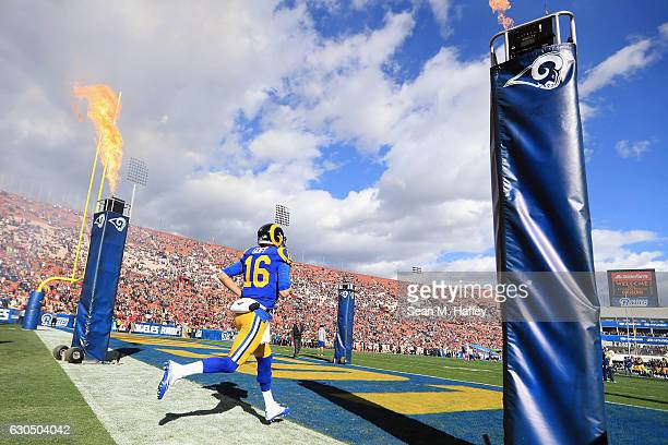 Jared Goff of the Los Angeles Rams runs onto the field before the game against the San Francisco 49ers at Los Angeles Memorial Coliseum on December...