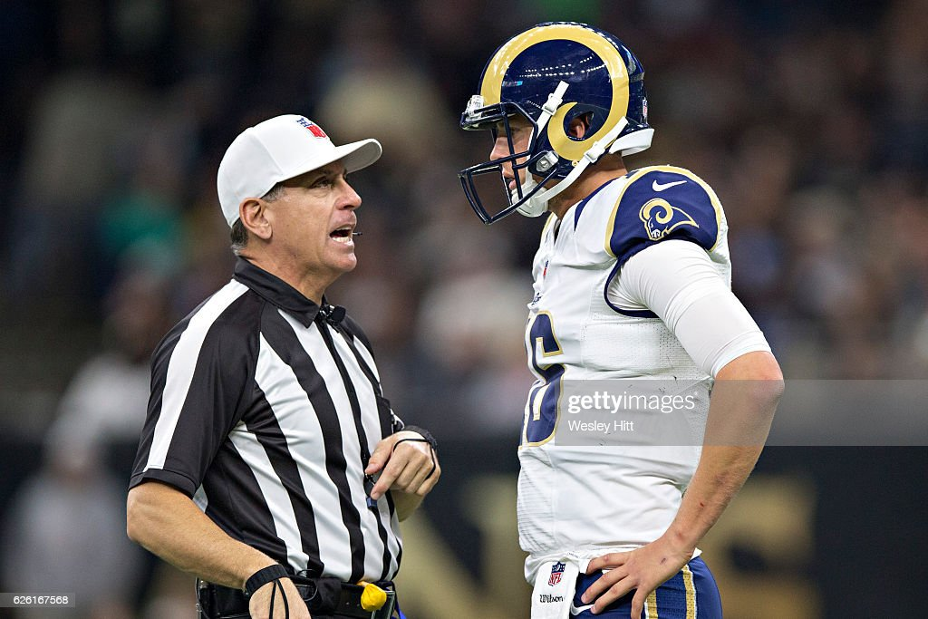 Jared Goff #16 of the Los Angeles Rams talks with Referee John Hussey during a game against the New Orleans Saints at Mercedes-Benz Superdome on November 27, 2016 in New Orleans, Louisiana. The Saints defeated the Rams 49-21.