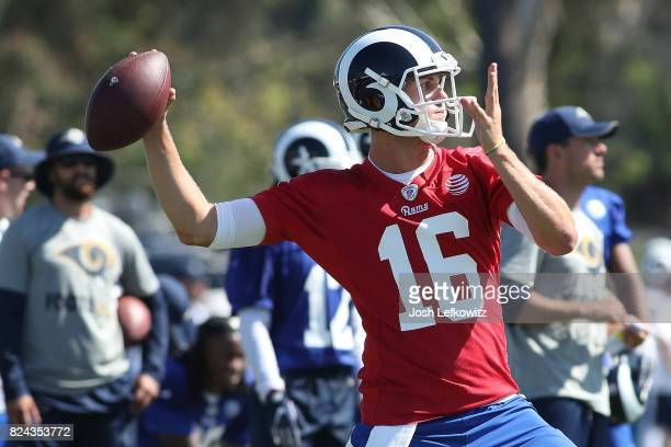 Jared Goff of the Los Angeles Rams throws a pass during the first day of Training Camp at Crawford Field on July 29 2017 in Irvine California