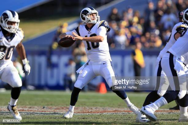 Jared Goff of the Los Angeles Rams throws a pass during the game against the New Orleans Saints at the Los Angeles Memorial Coliseum on November 26...