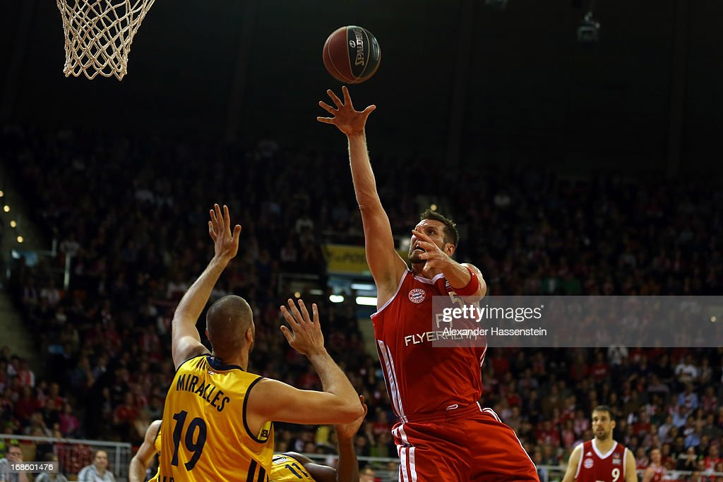 Jared Homan of Muenchen shoots against Albert Miralles of Berlin during Game 3 of the quarterfinals of the Beko Basketball Playoffs between FC Bayern Muenchen and ALBA Berlin at Audi-Dome on May 12, 2013 in Munich, Germany.