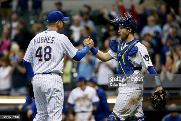 Jared Hughes and Jett Bandy of the Milwaukee Brewers celebrate after beating the New York Mets 74 at Miller Park on May 12 2017 in Milwaukee Wisconsin