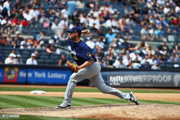 Jared Hughes of the Milwaukee Brewers pitches against the New York Yankees during their game at Yankee Stadium on July 8 2017 in the Bronx borough of...