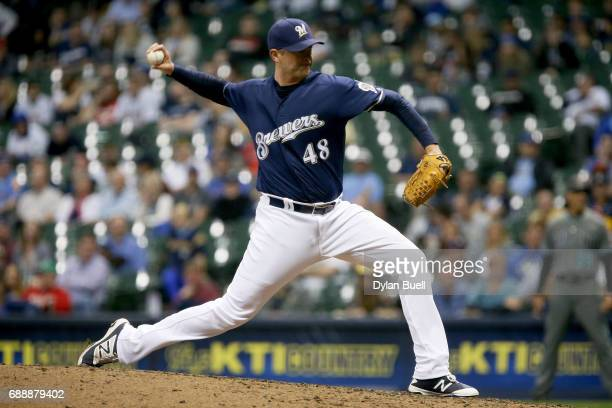 Jared Hughes of the Milwaukee Brewers pitches in the eighth inning against the Arizona Diamondbacks at Miller Park on May 25 2017 in Milwaukee...