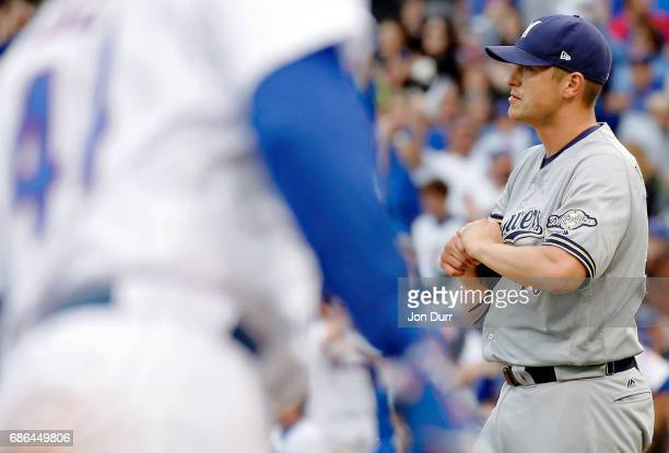 Jared Hughes of the Milwaukee Brewers reacts after giving up a two run home run to Anthony Rizzo during the eighth inningof the Chicago Cubs at...