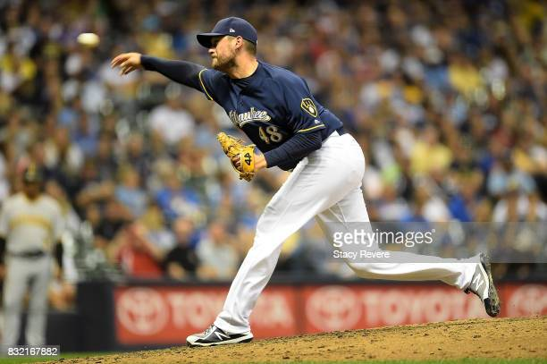 Jared Hughes of the Milwaukee Brewers throws a pitch during the seventh inning of a game against the Pittsburgh Pirates at Miller Park on August 15...