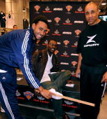 Jared Jeffries a fan and John Starks attend the Foot Locker and New York Knicks search for the biggest foot in New York at the Foot Locker flagship...