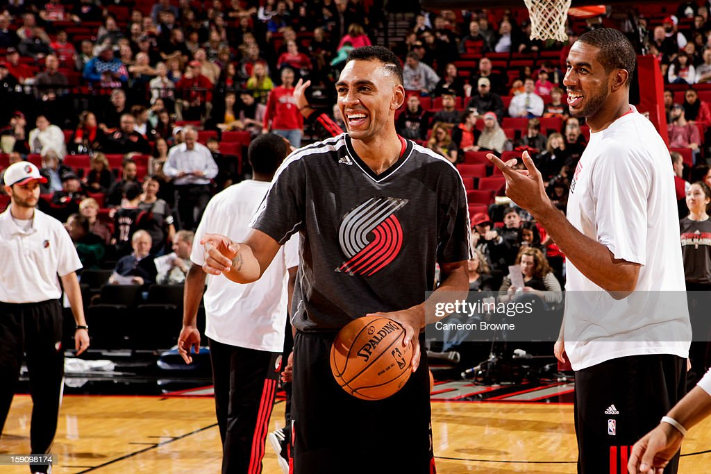 Jared Jeffries #1 and LaMarcus Aldridge #12 of the Portland Trail Blazers share a laugh during warm-up before playing the Orlando Magic on January 7, 2013 at the Rose Garden Arena in Portland, Oregon.