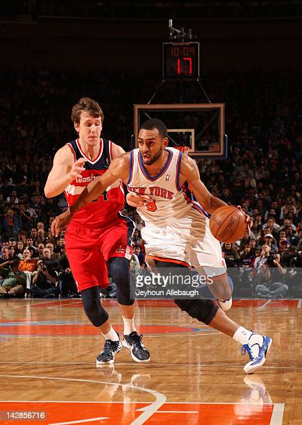 Jared Jeffries of the New York Knicks drives to the basket against Jan Vesely of the Washington Wizards during the game on April 13 2012 at Madison...