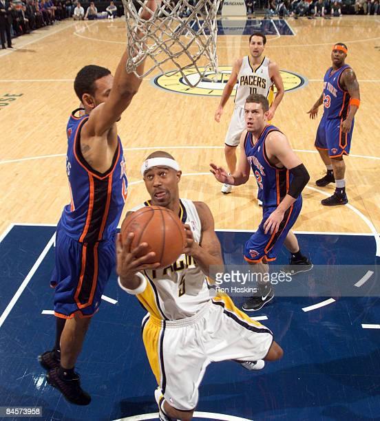 Jared Jeffries of the New York Knicks looks to block the shot of TJ Ford of the Indiana Pacers at Conseco Fieldhouse on January 31 2009 in...