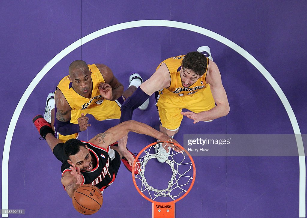 Jared Jeffries #1 of the Portland Trail Blazers attempts a layup in front of Kobe Bryant #24 and Pau Gasol #16 of the Los Angeles Lakers at Staples Center on December 28, 2012 in Los Angeles, California.