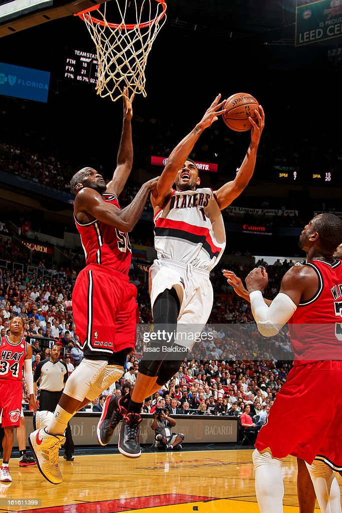 <a gi-track='captionPersonalityLinkClicked' href=/galleries/search?phrase=Jared+Jeffries&family=editorial&specificpeople=202548 ng-click='$event.stopPropagation()'>Jared Jeffries</a> #1 of the Portland Trail Blazers drives to the basket against <a gi-track='captionPersonalityLinkClicked' href=/galleries/search?phrase=Joel+Anthony&family=editorial&specificpeople=4092295 ng-click='$event.stopPropagation()'>Joel Anthony</a> #50 of the Miami Heat on February 12, 2013 at American Airlines Arena in Miami, Florida.