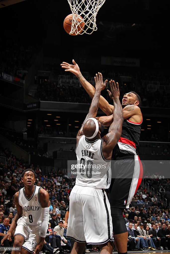 Jared Jeffries #1 of the Portland Trail Blazers puts up a shot over Reggie Evans #30 of the Brooklyn Nets on November 25, 2012 at the Barclays Center in the Brooklyn Borough of New York City.