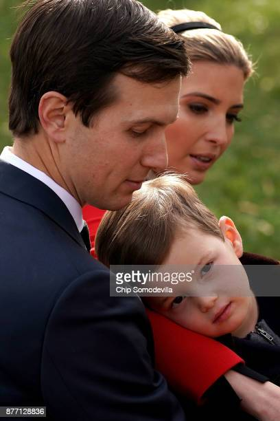 Jared Kushner senior advisor and soninlaw to US President Donald Trump his wife Ivanka Trump and their son Joseph Kushner wait for the pardoning...