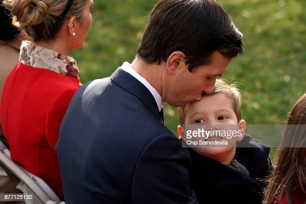 Jared Kushner senior advisor and soninlaw to US President Donald Trump kisses his son Joseph Kushner before the pardoning ceremony for the National...