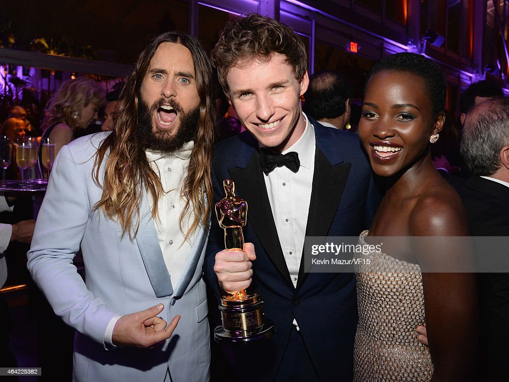 Jared Leto, Eddie Redmayne and Lupita Nyong'o attend the 2015 Vanity Fair Oscar Party hosted by Graydon Carter at the Wallis Annenberg Center for the Performing Arts on February 22, 2015 in Beverly Hills, California.