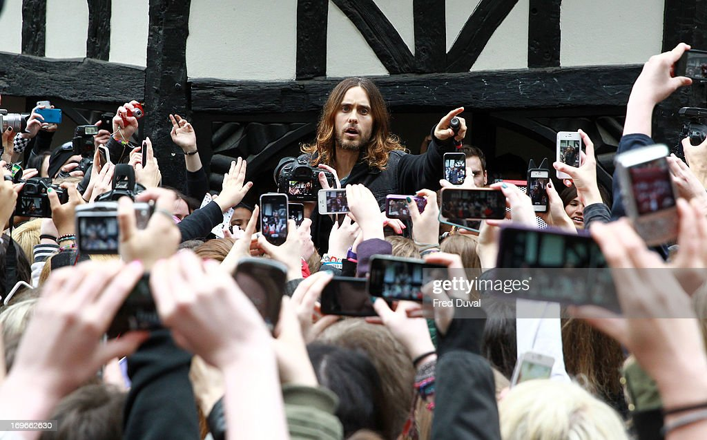 <a gi-track='captionPersonalityLinkClicked' href=/galleries/search?phrase=Jared+Leto&family=editorial&specificpeople=214764 ng-click='$event.stopPropagation()'>Jared Leto</a> from 30 Seconds to Mars busking at Soho Square on May 30, 2013 in London, England.