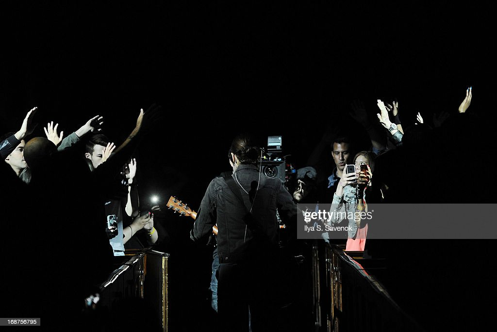 <a gi-track='captionPersonalityLinkClicked' href=/galleries/search?phrase=Jared+Leto&family=editorial&specificpeople=214764 ng-click='$event.stopPropagation()'>Jared Leto</a> of the band 30 Seconds to Mars performs during the 'Love Lust Faith & Dreams' Album Preview Concert at The New York Theatre At Saint Peter's Church At Citicorp on May 14, 2013 in New York City.