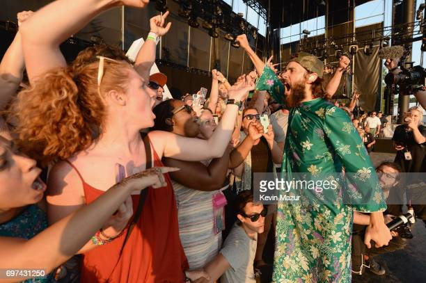 Jared Leto of Thirty Seconds to Mars performs onstage with fans during the 2017 Firefly Music Festival on June 18 2017 in Dover Delaware