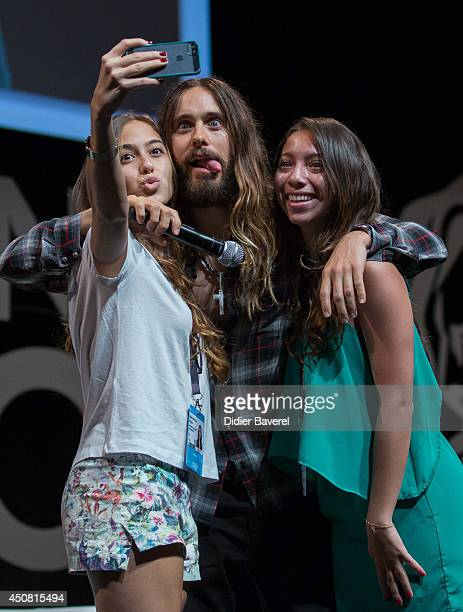 Jared Leto poses with fans for a selfie during the 'Clear Channel Media and Entertainment' at the 2014 Cannes Lions on June 18 2014 in Cannes France
