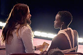 Jared Leto talks with Lupita Nyong'o in the front row during the 87th Annual Academy Awards at Dolby Theatre on February 22 2015 in Hollywood...