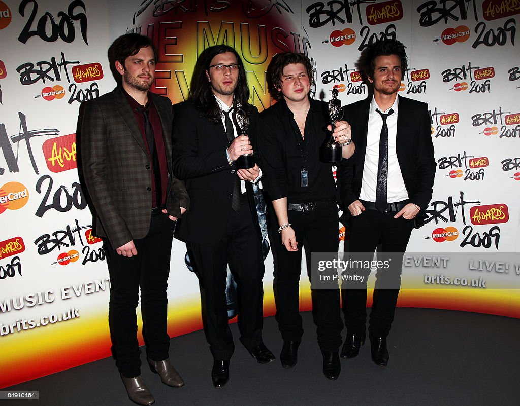 Jared Matthew Caleb and Nathan Followill from The Kings of Leon pose backstage after winning the Best International Group and International Album at...