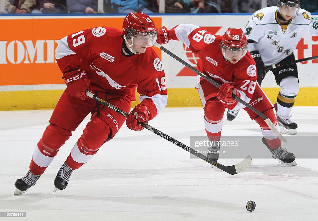 Jared McCann #19 of the Sault Ste. Marie Greyhounds skates with the puck against the London Knights during an OHL game at the Budweiser Gardens on December 4, 2013 in London, Ontario, Canada. The Knights defeated the Greyhounds 3-2.