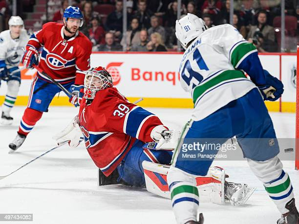 Jared McCann of the Vancouver Canucks shoots the puck towards the net of goaltender Mike Condon of the Montreal Canadiens during the NHL game at the...