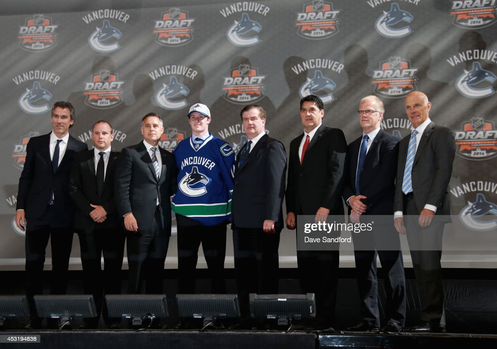 Jared McCann stands with team personnel after being selected 24th overall by the Vancouver Canucks during the 2014 NHL Entry Draft at Wells Fargo Center on June 27, 2014 in Philadelphia, Pennsylvania.