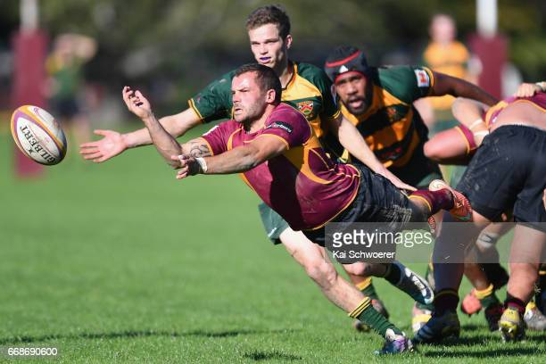 Jared Mitchell of University offloads the ball during the Hawkins Premier Cup match between Canterbury University and Belfast RFC at Ilam Fields on...