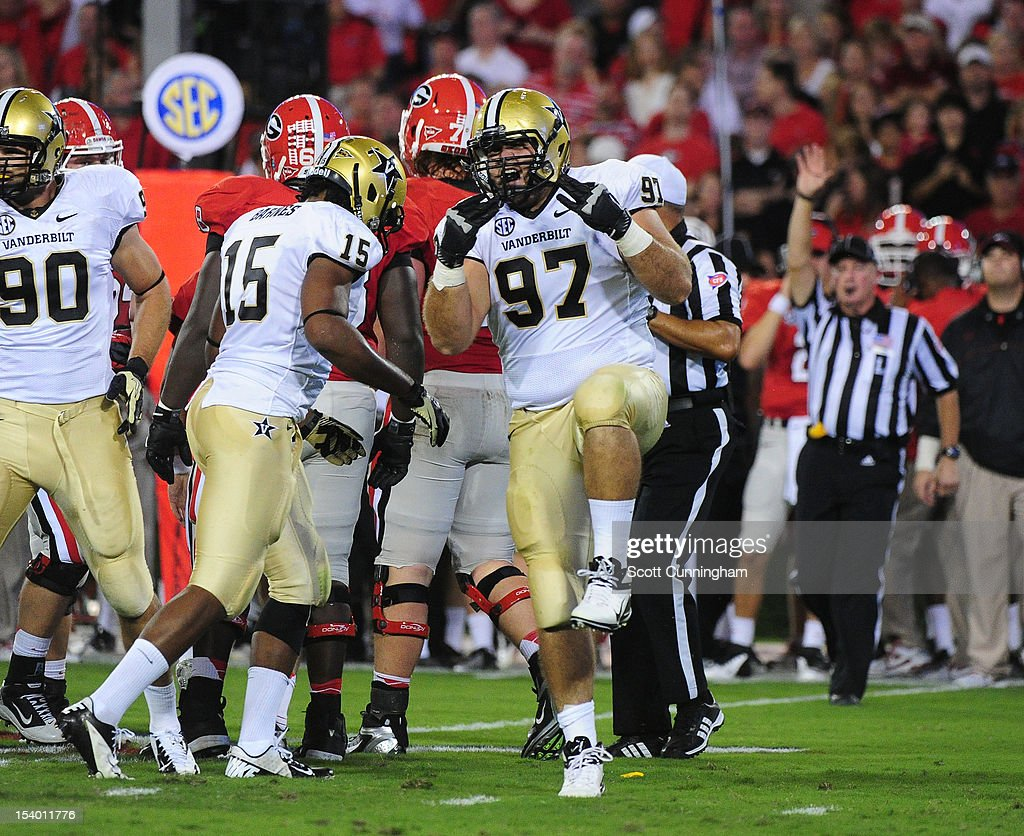 Jared Morse #97 of the Vanderbilt Commodores celebrates after a tackle against the Georgia Bulldogs at Sanford Stadium on September 22, 2012 in Athens, Georgia.