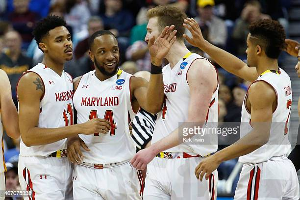 Jared Nickens Dez Wells Evan Smotrycz and Melo Trimble of the Maryland Terrapins react during the second round of the Men's NCAA Basketball...