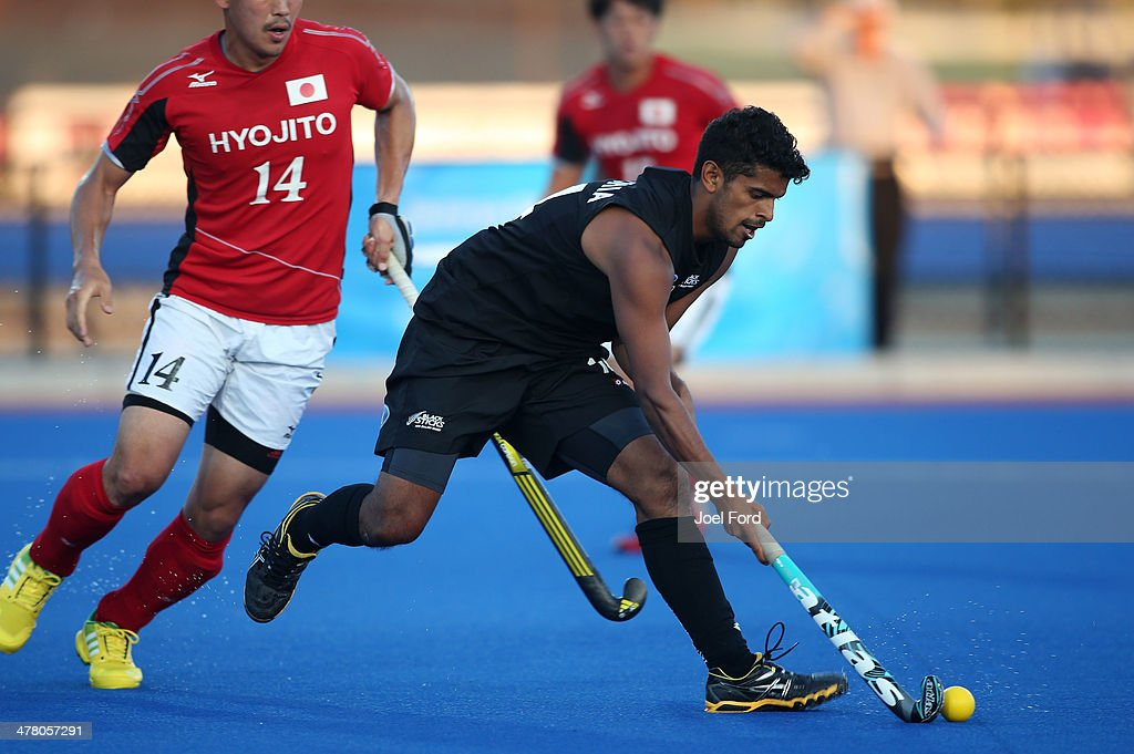 Jared Panchia of New Zealand runs with the ball during the Test Match between the New Zealand Black Sticks and Japan at Blake Park on March 12, 2014 in Mount Maunganui, New Zealand.